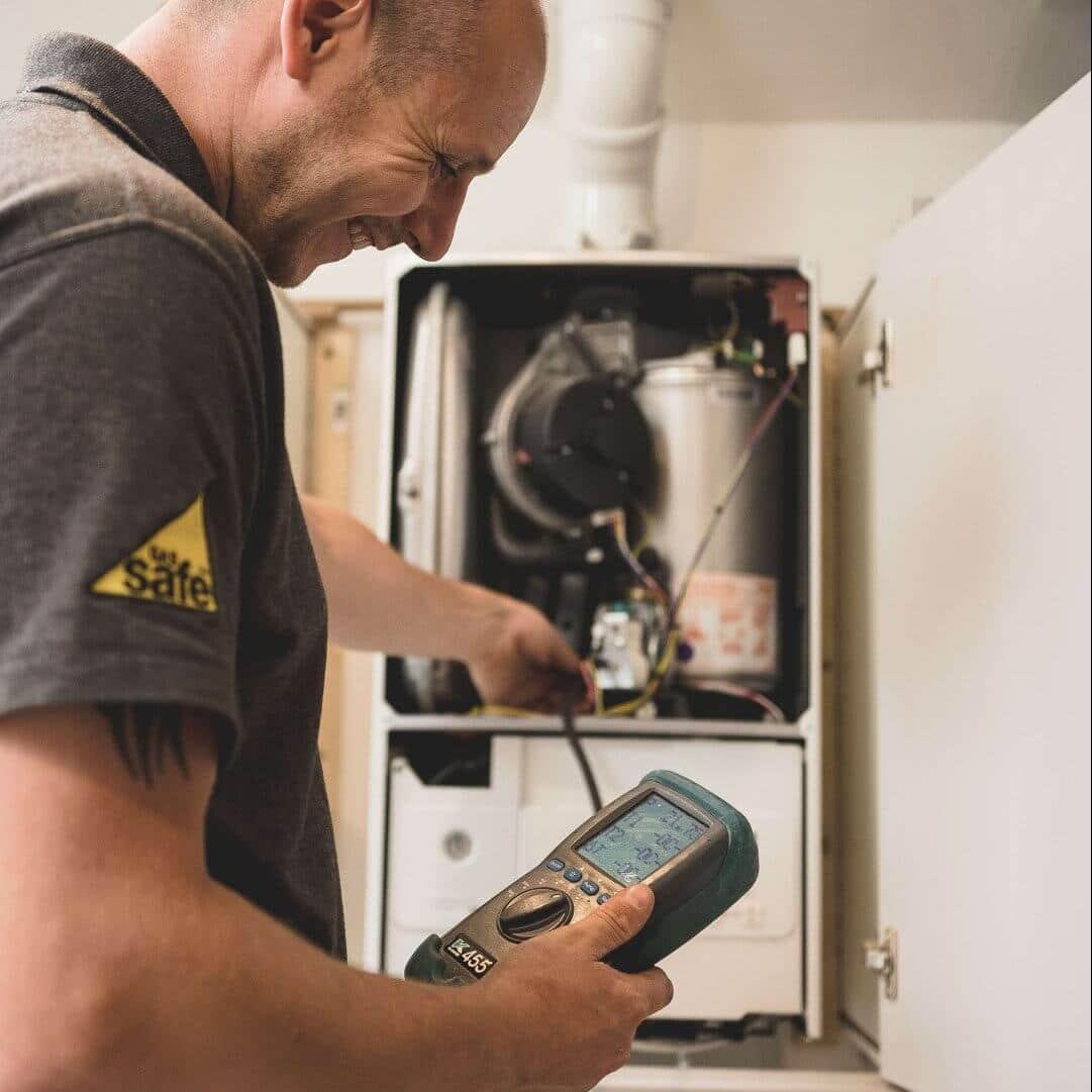 Lacey Plumbing & Heating boiler engineer testing boiler performance